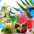 Glasses of cocktails on table on blue sky background